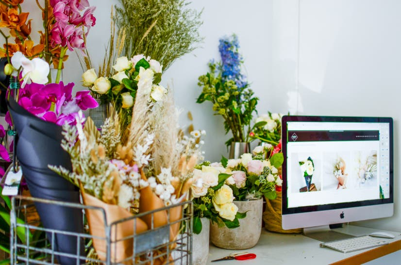 Bouqets of flowers next to a computer